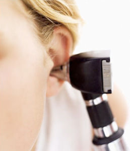 A woman getting her ear examined at Associated Hearing Professionals in St. Louis, MO