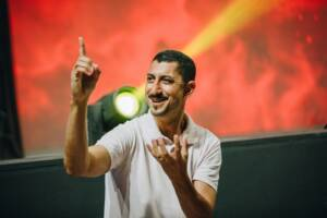A man on a stage doing sign language
