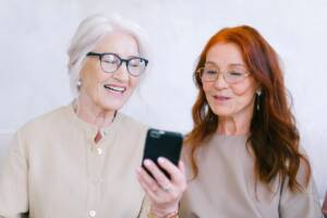 Two women using smartphone audiology features